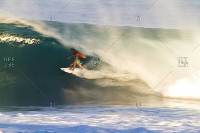 Surfer riding a pipeline