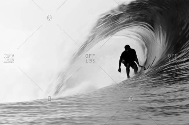 Surfer inside a perfect tube, Tahiti