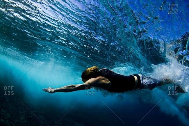 Bodysurfing man in the Pacific Ocean
