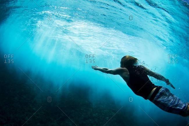 Bodysurfing man at Teahupoo in Tahiti