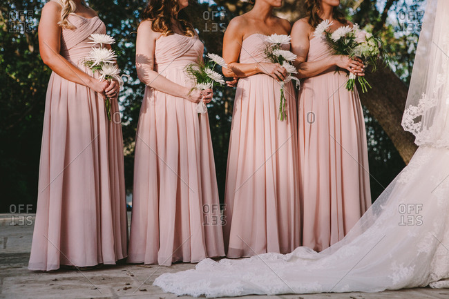 Bride and bridesmaids during wedding ceremony