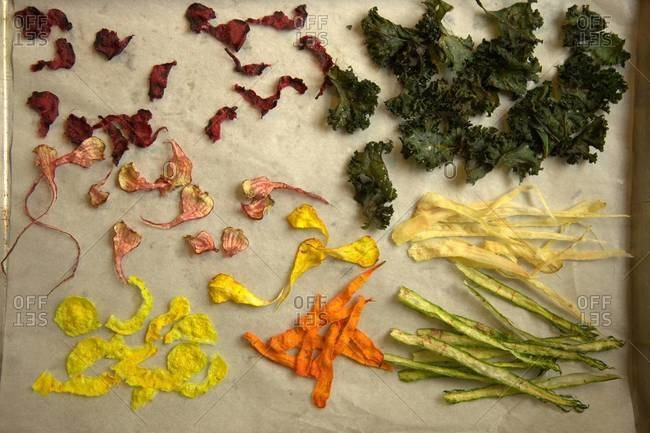 Colorful vegetable chips on a parchment paper