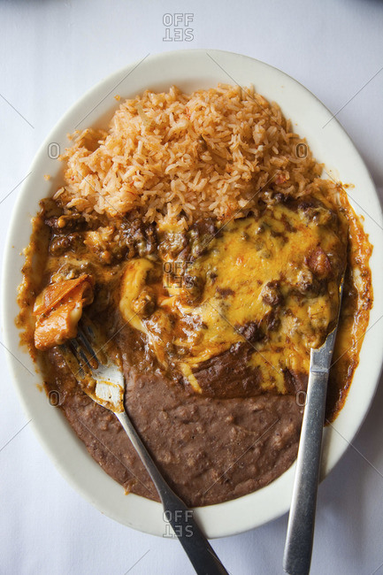 Typical Mexican cheesy dish made from rice and bean puree