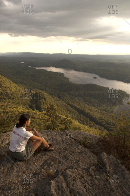 Woman sitting on Rattlesnake Cliffs in the Moosalamoo National Recreation Area, Vermont