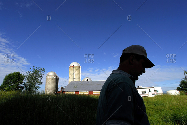 Vermont, USA - March 27, 2006: Mexican migrant worker on a dairy farm