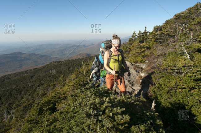 Vermont, USA - October 9, 2011: Woman hiking at Camel's Hump