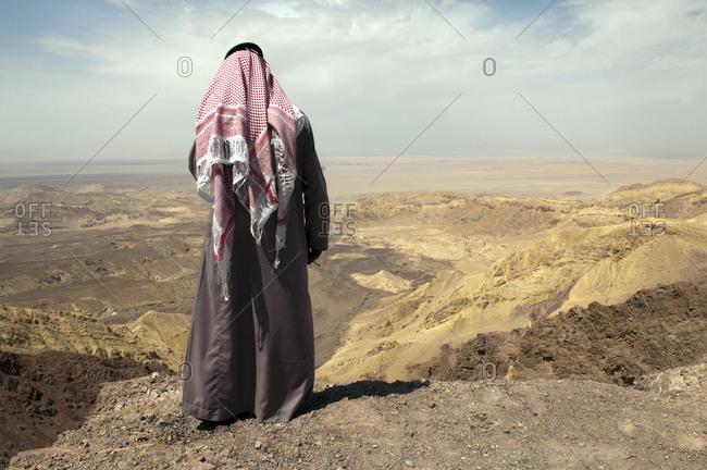 Bedouin person standing in the Jordan Desert