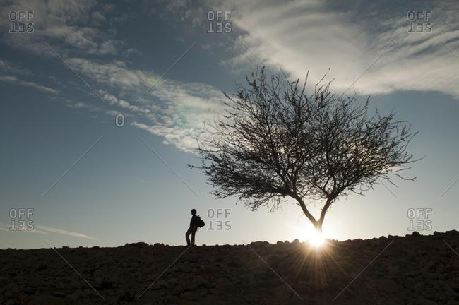 Woman hiking in Arabah, Jordan