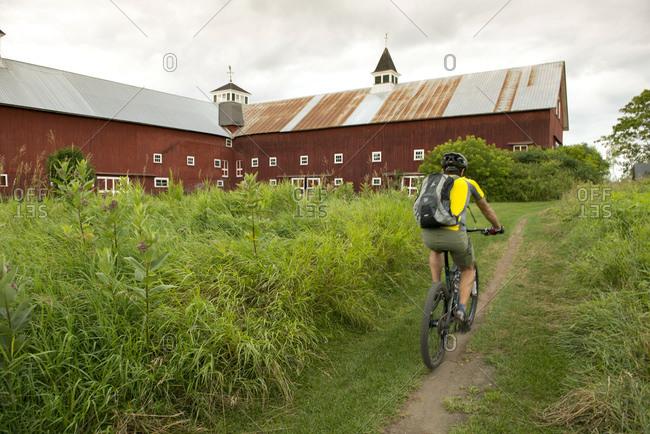 Man mountain biking on the Kingdom Trails in East Burke, Vermont
