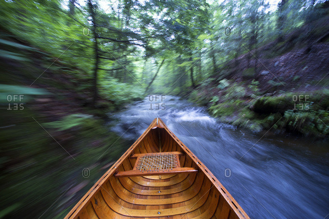 Canoe going down a creek in Hyde Park, Vermont