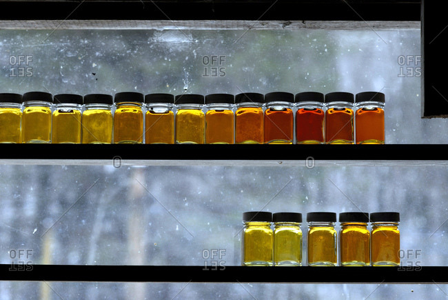Samples of maple syrup lined up on a window sill at a sugar house in Westminster West, Vermont