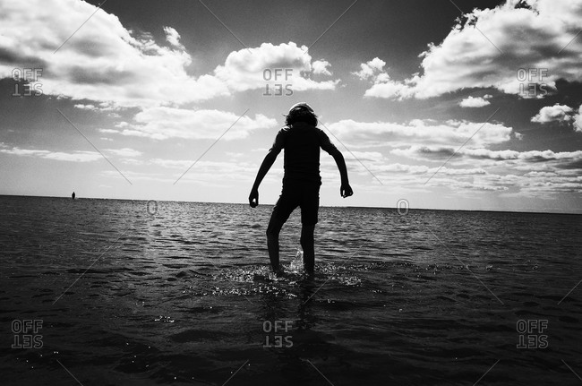 Young boy standing in a sea