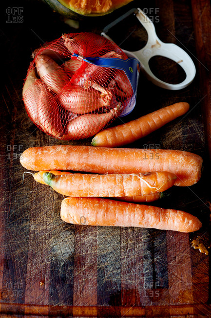 Fresh carrots and a bag of shallots