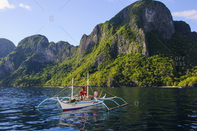 Palawan, Philippines, Southeast Asia, Asia - April 26, 2012: Outrigger boat in  the Bacuit archipelago