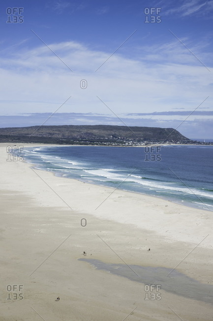 Expansive stretch of Long Beach with miniature sized people