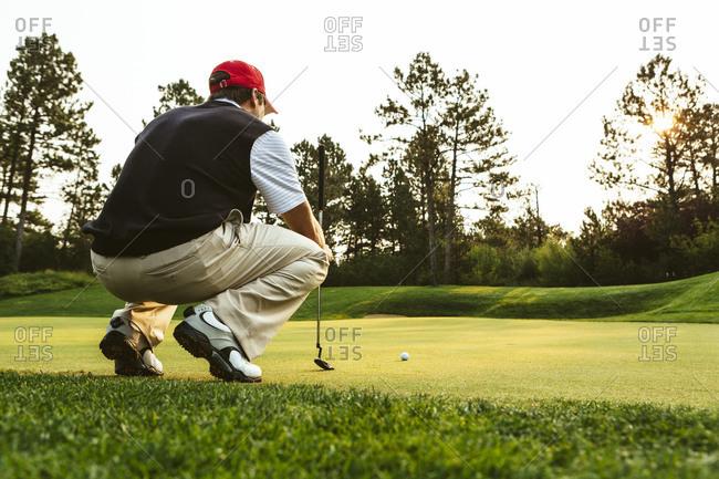 Golfer lining up a putt