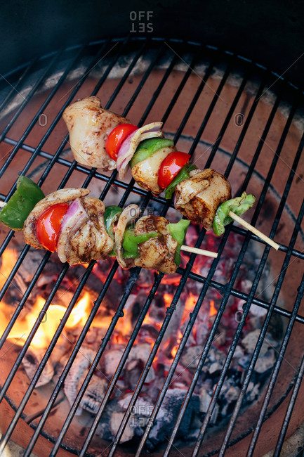 Chicken skewers on a grill grid
