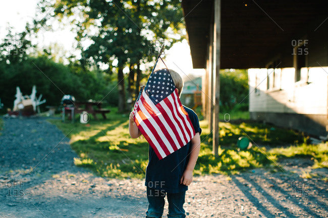 Boy holding an American flag