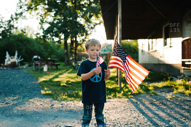Boy waving American flags