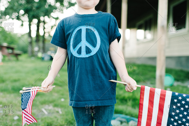 Boy holding American flags