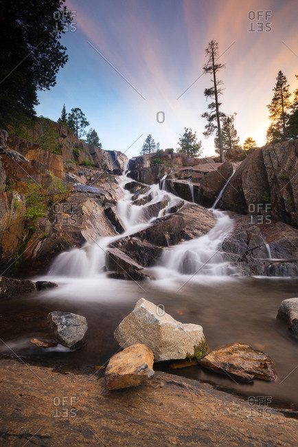 Glen Alpine Falls cascades down the rocks of Glen Alpine Creek at sunset near Fallen Leaf Lake and South Lake Tahoe, California