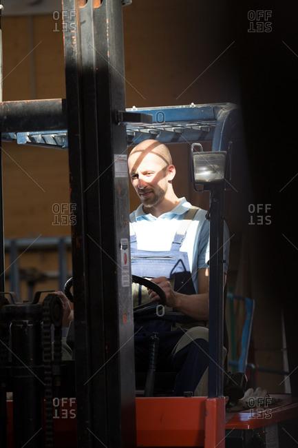 Warehouseman on forklift truck - Offset