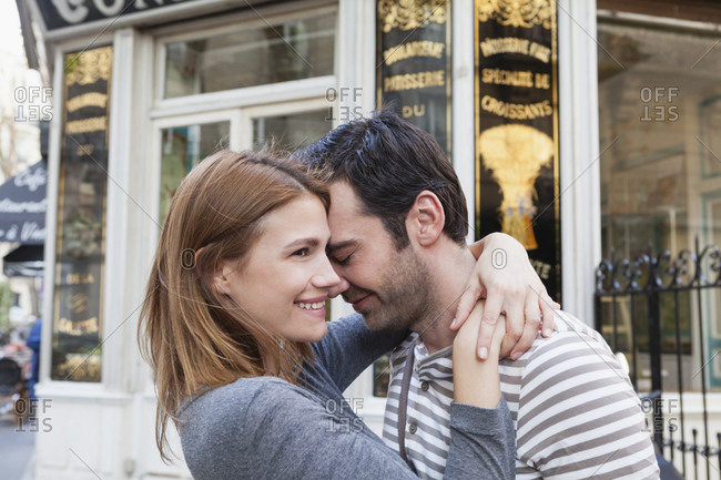 Couple in love in front of pastry shop