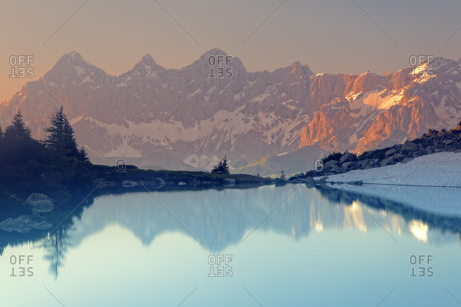 View to Dachstein, Lake Spiegelsee in the evening