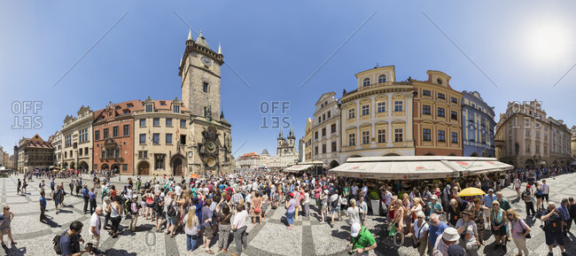 Prague, Czech Republic - June 12, 2014: Crowds of tourists in front of the Astronomical clock at Old Town Hall with Tyn Cathedral in the background