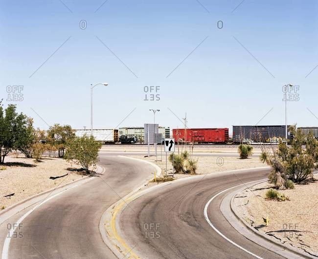 Train passing through a road junction nearby the border of California and Nevada, USA