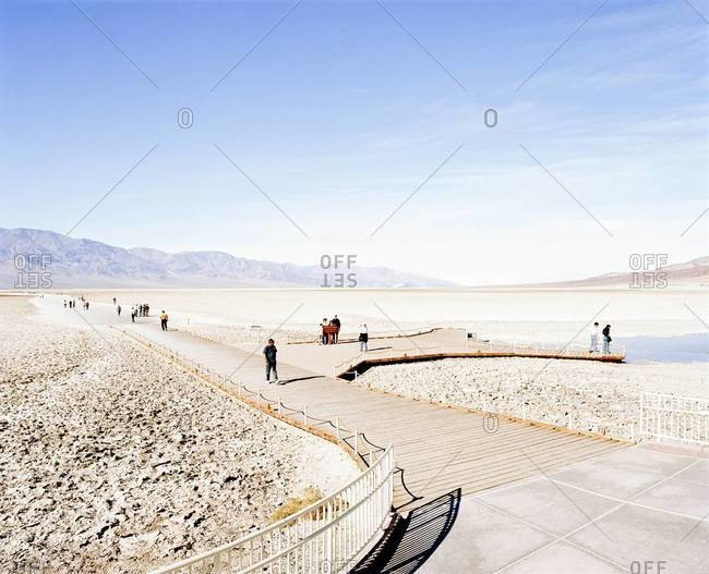 Tourists on a boardwalk in Badwater Basin, Death Valley National Park, USA