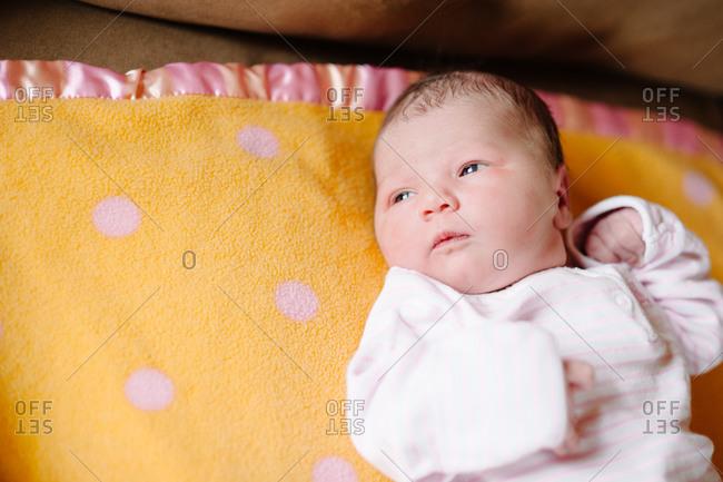 Newborn baby lying on a blanket