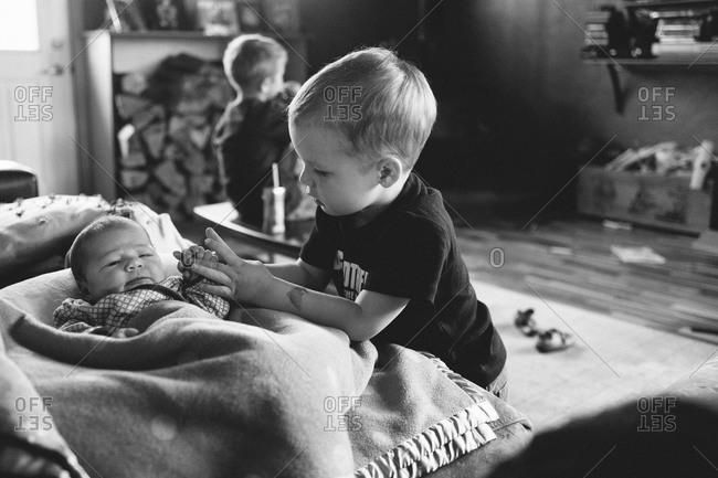 Boy comforting his baby sister