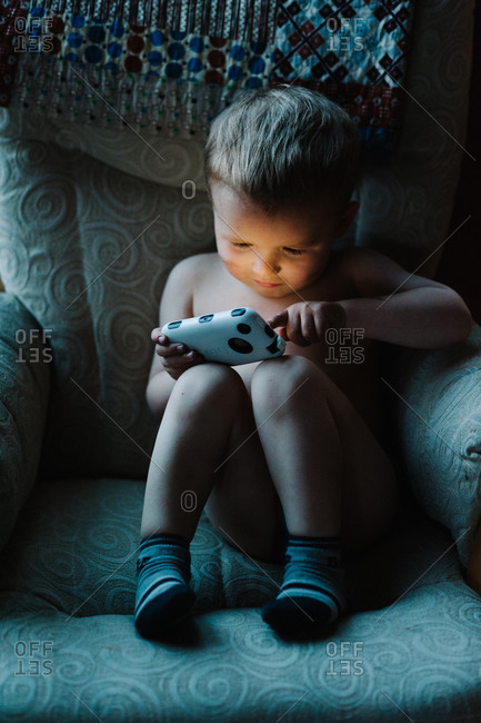 Boy playing with a smartphone