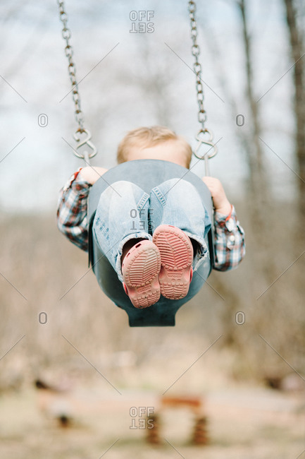 Child swinging in a park