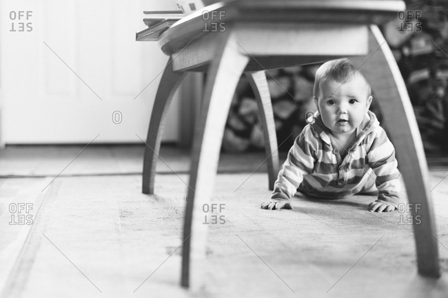 Baby crawling on a floor