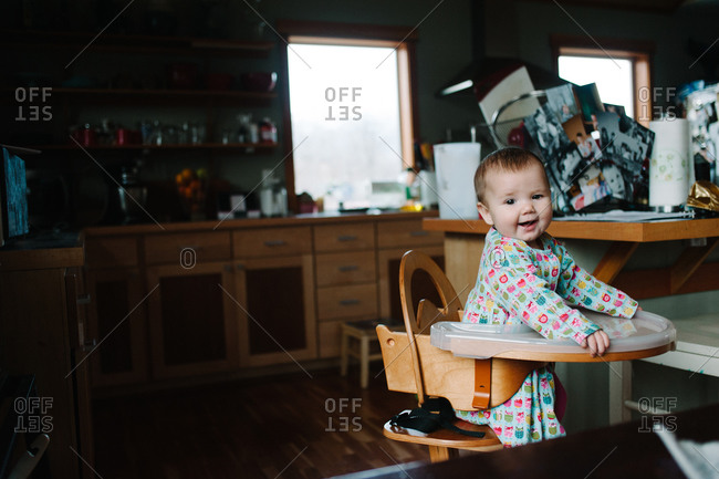Child sitting in a high chair