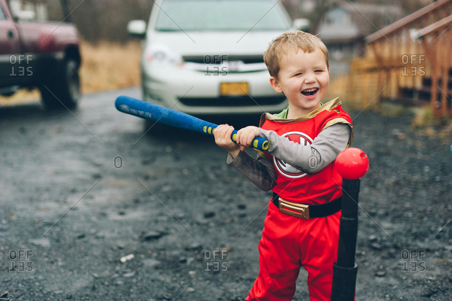 Boy in a costume holding a baseball bat