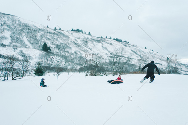 Man pulling a sled on a snowy field