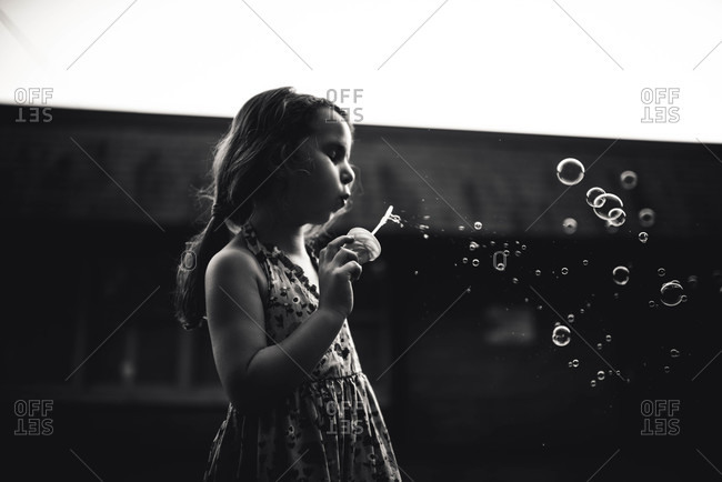 Girl blowing bubbles - Offset Collection