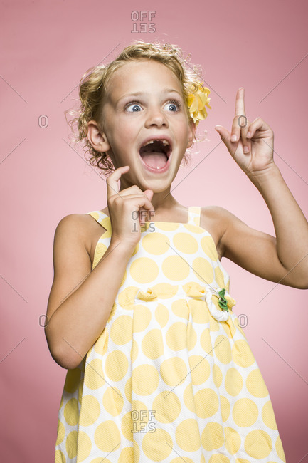 Studio shot of a surprised cute girl