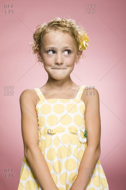 Studio shot of a blonde girl in summer dress