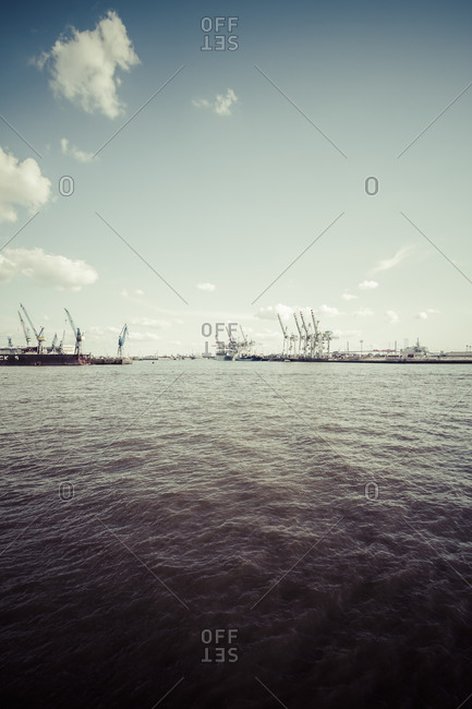 Ship and cranes at container terminal Tollerort