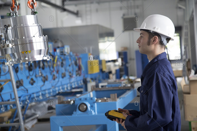 Technician in a factory building