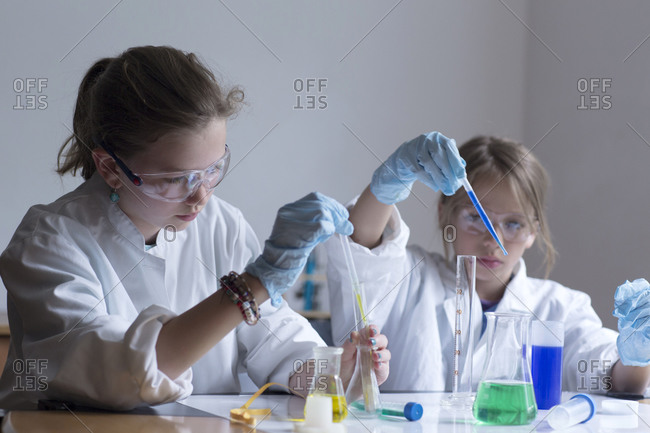 Two pupils doing chemical experiment