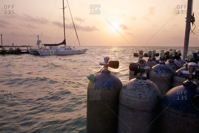 Scuba diving air tanks are lined up on the dock at San Pedro, Ambergris Island