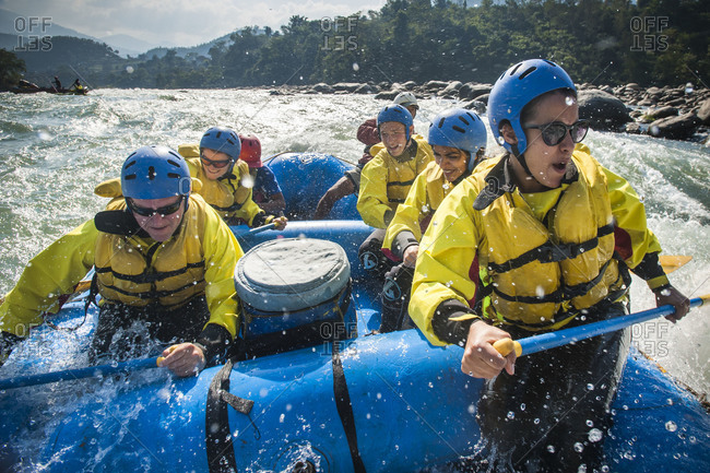 Rafters get splashed as they go through some big rapids on the Trisuli river in Nepal