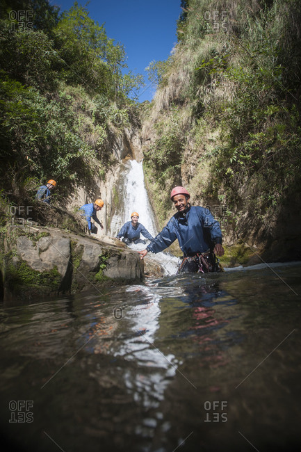Canyoning down waterfalls and through pools of water in Nepal near the Tibetan border