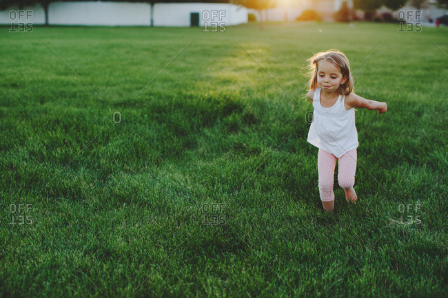 Young girl running in a field