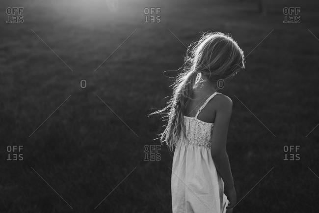 Lone girl standing in a field